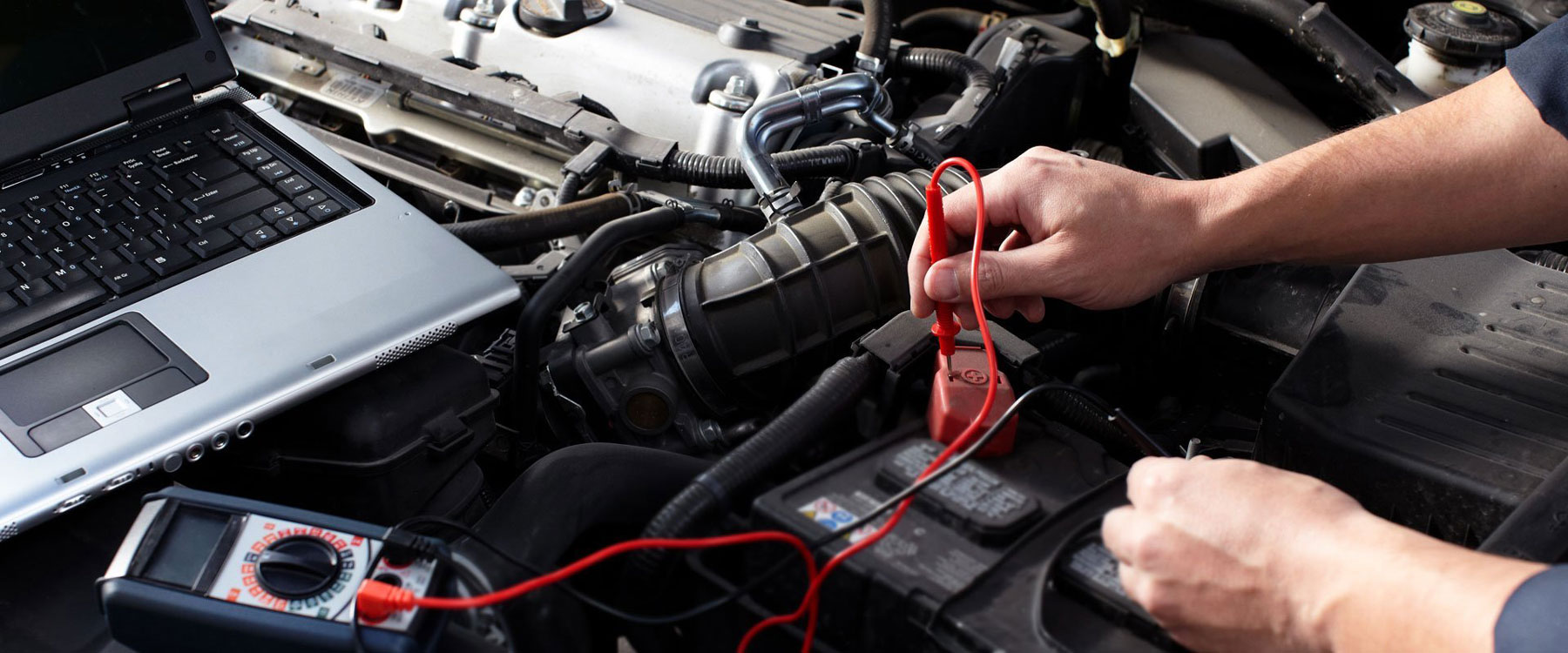 Auto Electrician working on car battery
